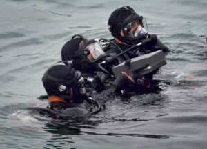 US Navy Divers preparing for interment of ashes inside the USS Arizona