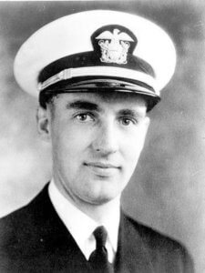 Facts about the USS Oklahoma: Father Aloysius Schmitt was the first American chaplain killed in WWII.